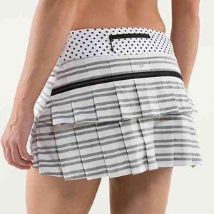 lululemon athletica Skirts - Lululemon Pace Runner Striped Tennis Skirt